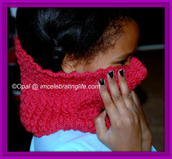 My daughter showing off her knitted cowl...